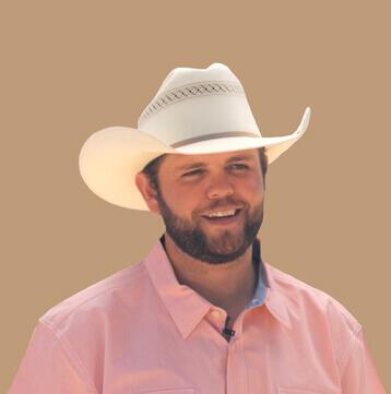 Headshot of Jordan wearing cowboy hat