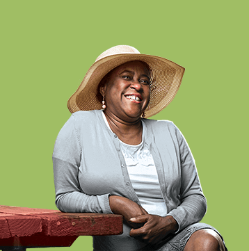 Headshot of Carey wearing a sun hat